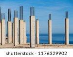 concrete pillars with sea in...   Shutterstock . vector #1176329902