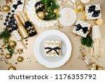 christmas table setting. gold... | Shutterstock . vector #1176355792