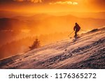 silhouette of a skier on the... | Shutterstock . vector #1176365272