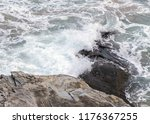 rock in the water washed by sea ... | Shutterstock . vector #1176367255
