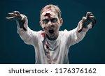 dead boy zombie. horror... | Shutterstock . vector #1176376162