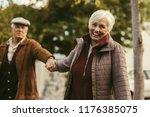 smiling senior woman holding...   Shutterstock . vector #1176385075