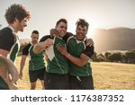 rugby players hugging and... | Shutterstock . vector #1176387352