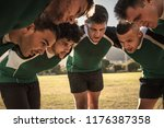 team of rugby players in huddle ... | Shutterstock . vector #1176387358