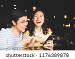 asian mother and daughter... | Shutterstock . vector #1176389878