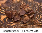 pieces of chocolate on dark... | Shutterstock . vector #1176395935