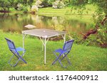 blue folding camping chairs... | Shutterstock . vector #1176400912