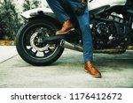 men's legs in classic leather... | Shutterstock . vector #1176412672