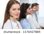 call center. beautiful cheerful ... | Shutterstock . vector #1176427885