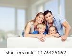 beautiful smiling family on... | Shutterstock . vector #1176429562