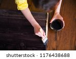 a woman paints planks with a... | Shutterstock . vector #1176438688
