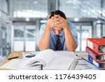 frustrated office manager... | Shutterstock . vector #1176439405