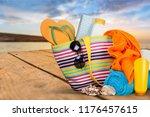 bag   flip flops on a tropical... | Shutterstock . vector #1176457615