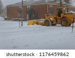 closeup of grader cleaning snow ... | Shutterstock . vector #1176459862