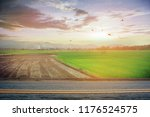 a photo of the road with sunset.... | Shutterstock . vector #1176524575