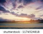 a photo of the road with sunset.... | Shutterstock . vector #1176524818