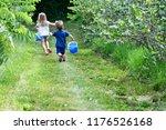 berry picking fun | Shutterstock . vector #1176526168