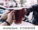 a beer toast. 3 amber ale beer... | Shutterstock . vector #1176534538