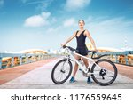 young sporty woman on city...   Shutterstock . vector #1176559645
