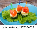 vegetable canapes served with... | Shutterstock . vector #1176564592