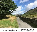 narrow country road in the... | Shutterstock . vector #1176576838