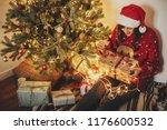 happy young woman in santa hat... | Shutterstock . vector #1176600532