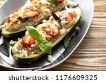 stuffed zucchini with meat and... | Shutterstock . vector #1176609325
