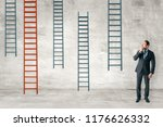 businessman with ladders on... | Shutterstock . vector #1176626332