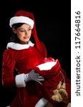 Santa Girl presenting your product, in costume and white gloves - stock photo