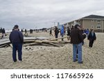 BELMAR, NEW JERSEY/USA- OCTOBER 30: People survey damage along the beach the day after Hurricane Sandy on October 30, 2012 in Belmar New Jersey. - stock photo