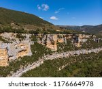 a canyon with a long river ... | Shutterstock . vector #1176664978