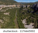 a canyon with a long river ... | Shutterstock . vector #1176665002