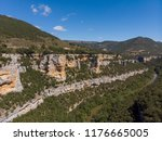 a canyon with a long river ... | Shutterstock . vector #1176665005