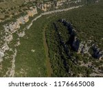 a canyon with a long river ... | Shutterstock . vector #1176665008