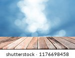 empty wooden table over blue... | Shutterstock . vector #1176698458