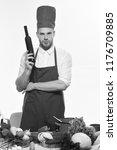 chef in burgundy uniform holds...   Shutterstock . vector #1176709885