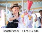 A Child Riding A Merry Go Round