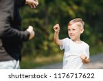 father teaches young child of... | Shutterstock . vector #1176717622