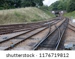 train on railway tracks  england | Shutterstock . vector #1176719812