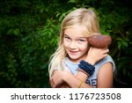 child blong girl posing in... | Shutterstock . vector #1176723508