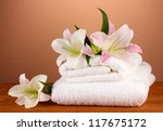 stack of towels with pink lily... | Shutterstock . vector #117675172