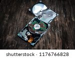 crushed hard disk drive on the... | Shutterstock . vector #1176766828