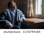 young man in old clothes... | Shutterstock . vector #1176794185