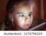 cute preschool girl looking... | Shutterstock . vector #1176796315