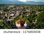 female tourist admiring view of ... | Shutterstock . vector #1176803038