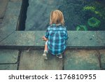 a little toddler is playing... | Shutterstock . vector #1176810955