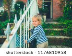 a laughing toddler is playing... | Shutterstock . vector #1176810958