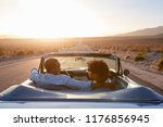 rear view of couple on road... | Shutterstock . vector #1176856945