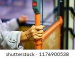 elder woman's hand holding a...   Shutterstock . vector #1176900538