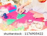 kid attaches stickers on paper... | Shutterstock . vector #1176905422